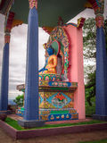 Buddhist statue. With trees and rain clouds - City of Gramado - Brazil Royalty Free Stock Images