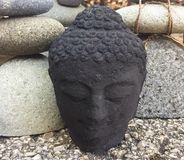 A Buddhist statue. An up close photo of a Buddhist statue in a rock garden stock image