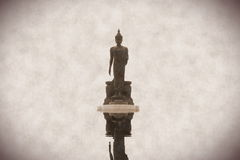 Buddhist statue on water reflect. In old stlye picture royalty free stock photo