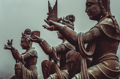 Buddhist statues praising and making offerings to Buddha. Buddhist statues praising and making offerings to the Tian Tan Buddha. The Po Lin Monastery and the Royalty Free Stock Photography