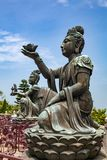 Buddhist statues praising and making offerings to the Tian Tan Buddha the Big Buddha at Lantau Island, in Hong Kong. Hong Kong is popular tourist destination of Royalty Free Stock Photography