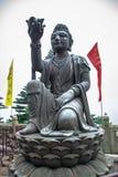 Buddhist statues praising the Tian Tan Buddha at Ngong Ping, Lantau Island, in Hong Kong. HONG KONG: Buddhist statues praising the Tian Tan Buddha at Ngong Ping Royalty Free Stock Photography