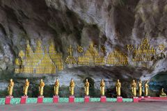 Buddhist statues row in cave Royalty Free Stock Photos