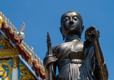 Buddhist statues at Thai temples. One of many Buddhist statues at a temple in Thailand.There are many of such temples around Thailand all very ornate, bright Stock Photo