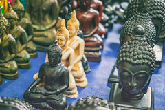 Buddhist statuettes and souvenirs at night market Stock Images