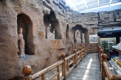Buddhist Stone Carving. Stone carving of Buddist grottoes in Gansu Museum, Lanzhou, Gansu province of China.Visiting Gansu Provincial Museum is a must for every Stock Photo