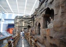Buddhist Stone Carving and stupa. White stupas and stone carving of Buddist show in Gansu Museum, Lanzhou, Gansu province of China.Visiting Gansu Provincial Royalty Free Stock Images