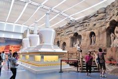 Buddhist Stone Carving and stupa. White stupas and stone carving of Buddist show in Gansu Museum, Lanzhou, Gansu province of China.Visiting Gansu Provincial Stock Photos