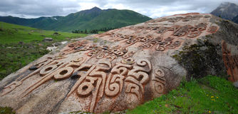 Buddhist stone carvings. On rocks Royalty Free Stock Images