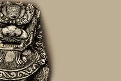 Buddhist stone statue. Royalty Free Stock Image