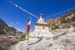 Buddhist stupa on Annapurna circuit trek. Himalayan mountains. Nepal. Buddhist stupa. Annapurna circuit trek. Himalayan mountains of Nepal royalty free stock image