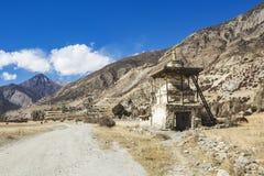 Buddhist stupa on Annapurna circuit trek. Himalayan mountains. Nepal. Buddhist stupa near Manang. Annapurna circuit trek. Himalayan mountains of Nepal stock photo