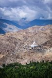 Buddhist stupa chorten on a hilltop in Himalayas Stock Image