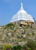 Buddhist stupa of enlightenment on the island on the lake Ogoy Stock Photography