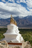 Buddhist stupa and Himalayas mountains in Ladakh, India Royalty Free Stock Images