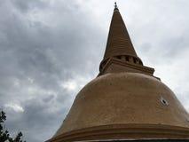Buddhist Stupa, Pra PathomChedi, Nakorn Pathom, Thailand. Serene peaceful green joy meditation aesthetic southeast asia tropical sacred religion sky stock photo