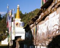 Buddhist stupa, prayer flags and Mani prayer wall Royalty Free Stock Photography
