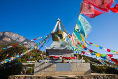 Buddhist stupa and prayer flags Stock Photos