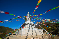 Buddhist stupa and prayer flags Stock Photography