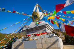 Buddhist stupa and prayer flags Stock Image