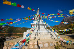 Buddhist stupa and prayer flags Royalty Free Stock Photography