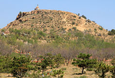 Buddhist stupa with prayers flags on top of hill, Inner Mongolia stock photography
