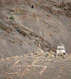 Buddhist stupa and stone swastika cross stock image