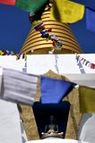 A buddhist stupa or temple, un templo budista y banderas tibetanas. A buddhist temple Stupa on a ritual or ceremony, meditation and people joining a religous Stock Photo