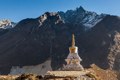 Buddhist stupa in Thame village with high rocky. Royalty Free Stock Photos