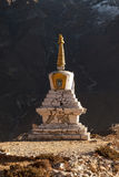 Buddhist stupa in Thame village with rocky. Stock Photos