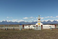 Buddhist stupa in the Tunkinsky valley against the Sayan mountains Stock Image