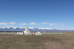 Buddhist stupa in the Tunkinsky valley against the Sayan mountains Royalty Free Stock Photography