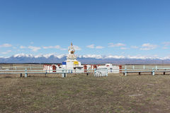 Buddhist stupa in the Tunkinsky valley against the Sayan mountains Royalty Free Stock Images