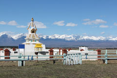 Buddhist stupa in the Tunkinsky valley against the  Sayan mountains Royalty Free Stock Photo