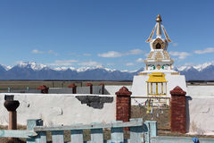 Buddhist stupa in the Tunkinsky valley against the  Sayan mountains Stock Photos