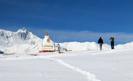 Buddhist stupa with two tourists in Annapurna area Stock Photos