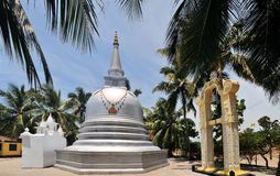 Buddhist Stupa under palm trees, Sri Lanka Stock Photos
