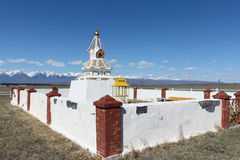 Buddhist stupa in the  valley against of the Sayan mountains Stock Photo