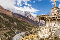 Buddhist stupa and valley. Great stupa made of rocks and wood at the top of the valley, Annapurna circuit, Himalaya, Nepal Royalty Free Stock Photo