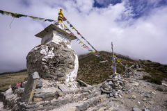 Buddhist stupa on the way to EBC on top of mountains. Royalty Free Stock Image