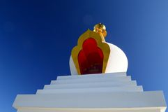 Buddhist stupa. A white buddhist stupa with blue skies Royalty Free Stock Photography