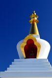 Buddhist stupa. White buddhist stupa with blue skies Stock Image