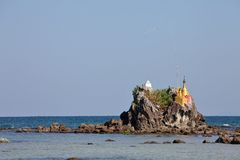 Buddhist stupas on the beach Stock Photography