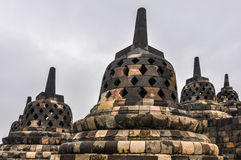 Buddhist stupas in Borobudur Temple, Indonesia. Buddhist temples in Borobudur Temple on Java Island, Indonesia Royalty Free Stock Photography