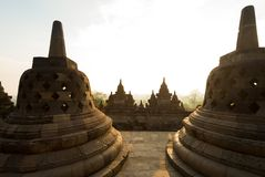 Buddhist stupas at dawn in Borobudur stock photography