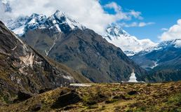 Buddhist stupe or chorten and Lhotse peaks in Himalayas Stock Images