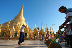 Buddhist sweep the compound  Shwedagon Pagoda. YANGON, MYANMAR - FEB 13: Buddhist devotees sweep the compound at the Shwedagon Pagoda on February 13, 2011 in Stock Photo
