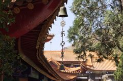 Buddhist symbols and hanging bell in Yuantong Temple stock photos