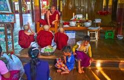 Buddhist teaching in monastery on Inle Lake, Myanmar. YWAMA, MYANMAR - FEBRUARY 18, 2018: The Bhikkhu monk preaches in Nga Phe Chaung Monastery of jumping cats Stock Photos