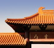 Buddhist temple. Exterior of buddhist temple rooftop with blue sky background Stock Photos